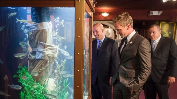 July 20, 2012. Los Angeles, California. Animal Planet's 'Tanked', co-stars,  Wayde King and Brett Raymer install a magician themed aquarium at The Magic Castle in Los Angeles. Actor Neil Patrick Harris who is president of The Academy of Magical Arts was present, overseeing the installation.  Pictured (L-R) Brett Raymer, Neil Patrick Harris and Wayde King.