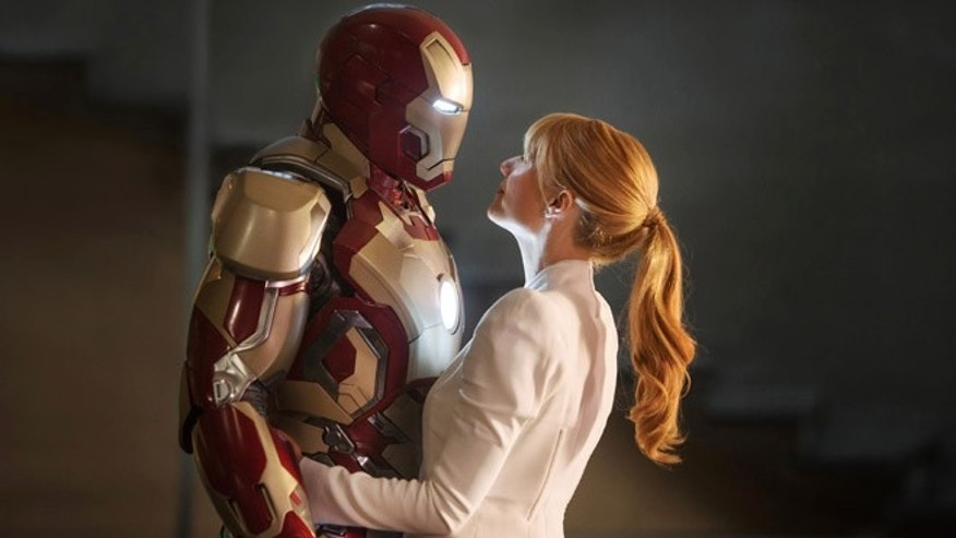"This film publicity image released by Disney-Marvel Studios shows Robert Downey Jr., left, as Tony Stark/Iron Man and Gwyneth Paltrow as Pepper Potts in a scene from ""Iron Man 3."""