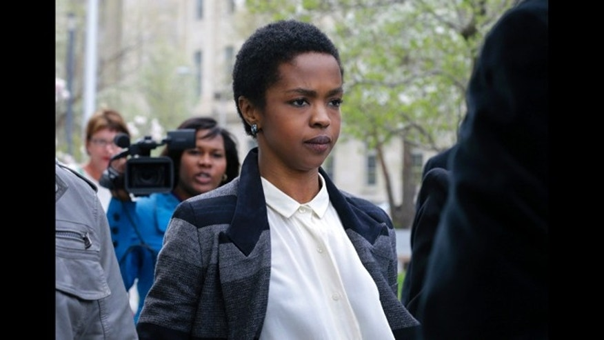 This April 22, 2013 file photo shows singer Lauryn Hill walking from federal court in Newark, N.J. Hill faced sentencing Monday, May 6, on federal tax charges.  Hill pleaded guilty last year to not paying federal taxes on $1.8 million earned from 2005 to 2007. A judge two weeks ago said Hill had paid only about $50,000 of more than $500,000 she owes.