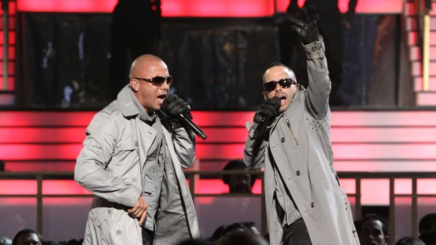 SAN JUAN, PUERTO RICO - APRIL 29: Juan Luis Morera Luna (L) and Llandel Veguilla Malavé Salazar of Wisin y Yandel perform onstage at the 2010 Billboard Latin Music Awards at Coliseo de Puerto Rico José Miguel Agrelot on April 29, 2010 in San Juan, Puerto Rico.  (Photo by John Parra/Getty Images)