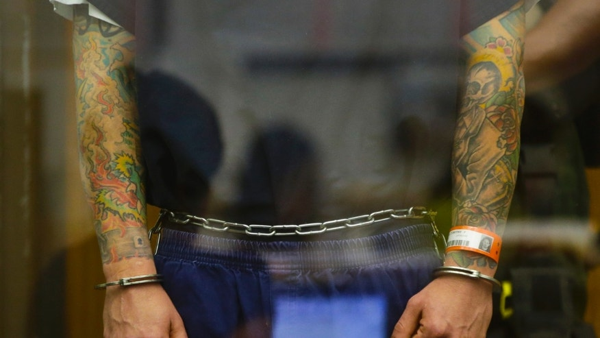 May 9, 2013: The shackled arms of Tim Lambesis, the lead singer for the metal band As I Lay Dying at his arraignment in Vista, Calif.