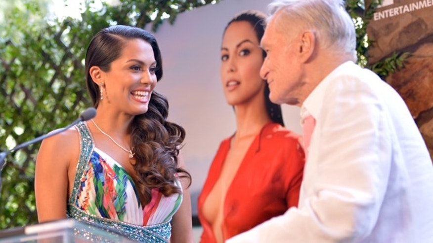 2013 Playmate Of The Year Raquel Pomplun,left, and Hugh Hefner speak onstage during Playboy's 2013 Playmate Of The Year luncheon at The Playboy Mansion on May 9, 2013 in Holmby Hills, California.  (Photo by Charley Gallay/Getty Images for Playboy)