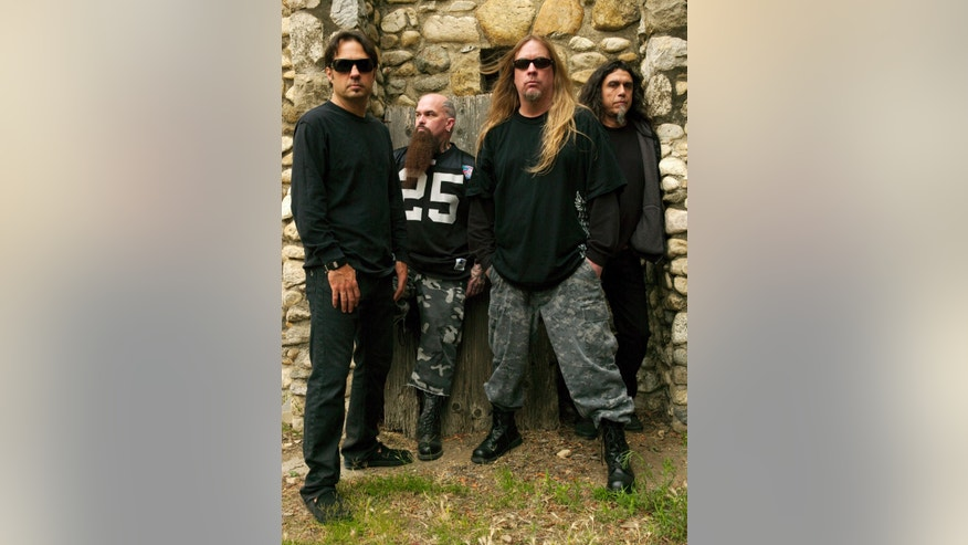 This 2009 publicity photo provided courtesy of Slayer shows, from left, Dave Lombardo, Kerry King, Jeff Hanneman and Tom Araya. Hanneman, 49, a founding member of the heavy metal band Slayer, has died. Slayer spokeswoman Heidi Robinson-Fitzgerald says Hanneman died Thursday morning, May 2, 2013, of liver failure at a Los Angeles hospital with his wife, Kathy, by his side.