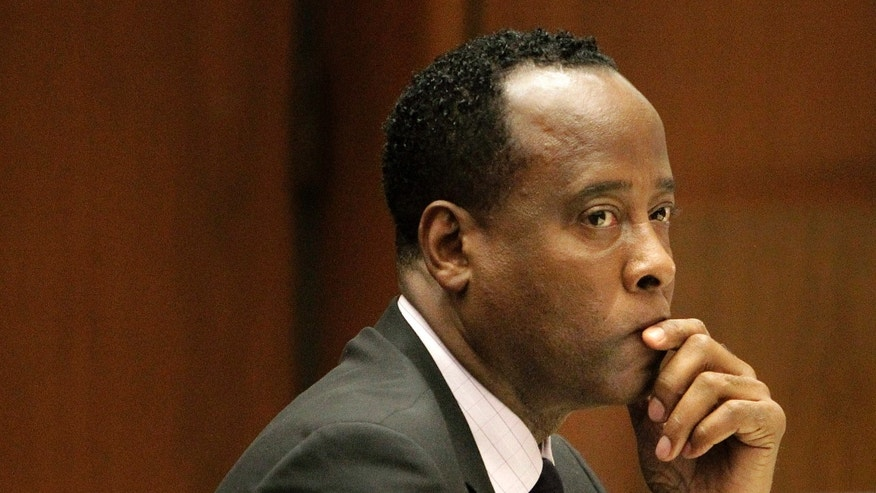 FILE - In this Friday, Oct. 21, 2011, file photo, Michael Jackson's former doctor Conrad Murray sits in a courtroom during his involuntary manslaughter trial in Los Angeles. Jurors hearing a civil case on Wednesday May 1,2013 against Jackson's concert promoter that Murray was more than $500,000 in debt and his finances were severely distressed. (AP Photo/Reed Saxon, Pool, File)