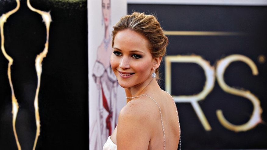 Jennifer Lawrence arrives at the 85th annual Academy Awards.