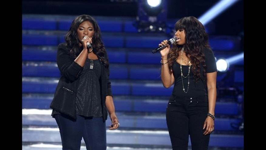 "May 16, 2013: Finalist Candice Glover, left, and Jennifer Hudson perform at the ""American Idol"" finale at the Nokia Theatre at L.A. Live in Los Angeles."