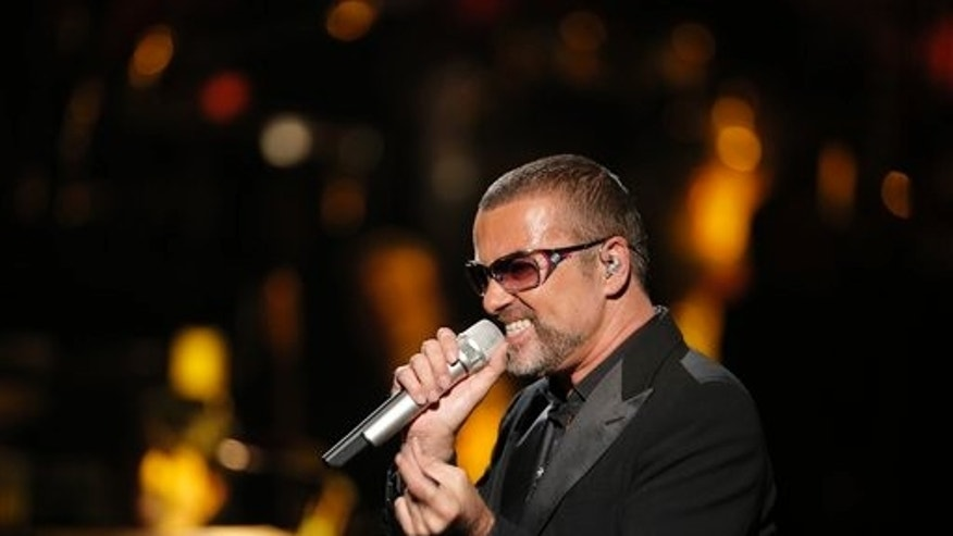 In this Sept. 9, 2012 file photo, British singer George Michael performs at a concert to raise money for AIDS charity Sidaction, during the Symphonica tour at Palais Garnier Opera house in Paris, France. George Michael's publicist says the singer is being treated for minor injuries after he was a passenger in a car crash.
