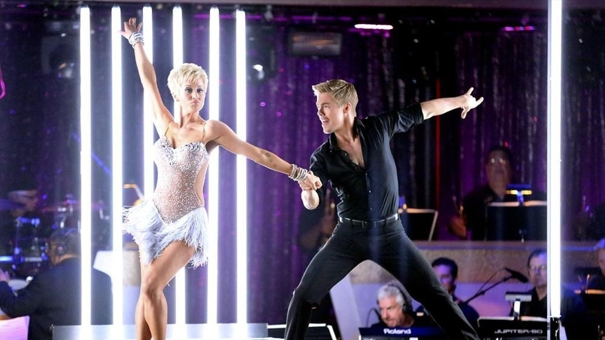 Singer Kellie Pickler and professional dancer Derek Hough competing on Dancing with the Stars.