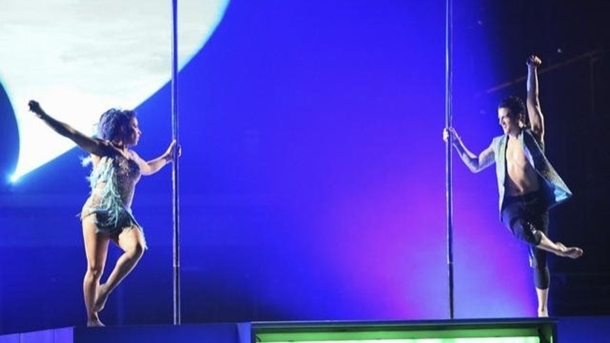 "Alexandra Raisman and Mark Ballas try pole dancing on ""Dancing with the Stars."""