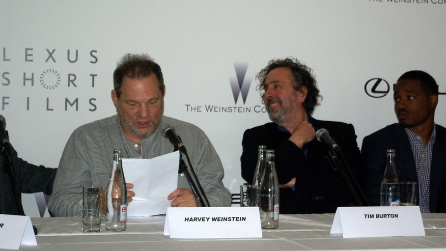Tim Burton and Harvey Weinstein speak at the Cannes Film Festival.