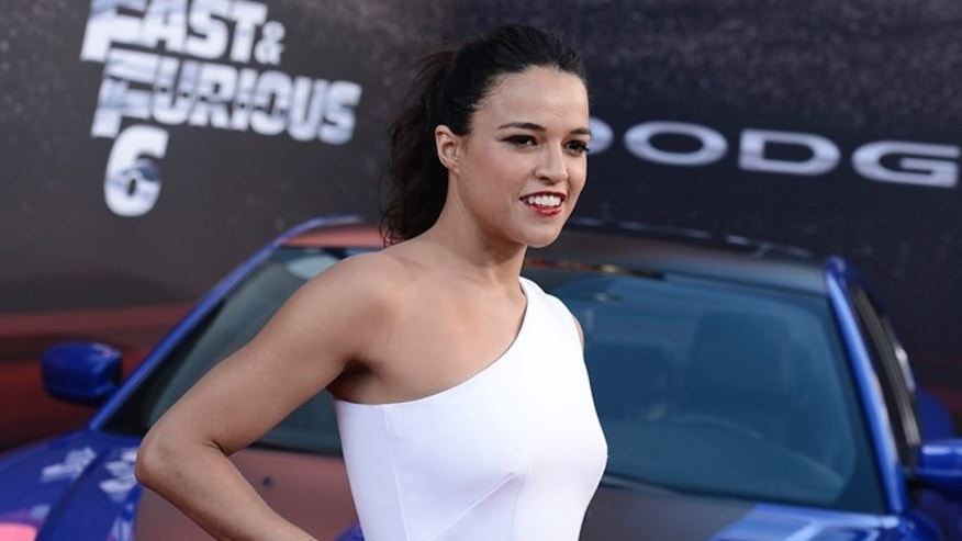 "Actress Michelle Rodriguez arrives at the LA Premiere of the ""Fast & Furious 6"" at the Gibson Amphitheatre on Tuesday, May 21, 2013 in Universal City, Calif. (Photo by Dan Steinberg/Invision/AP)"