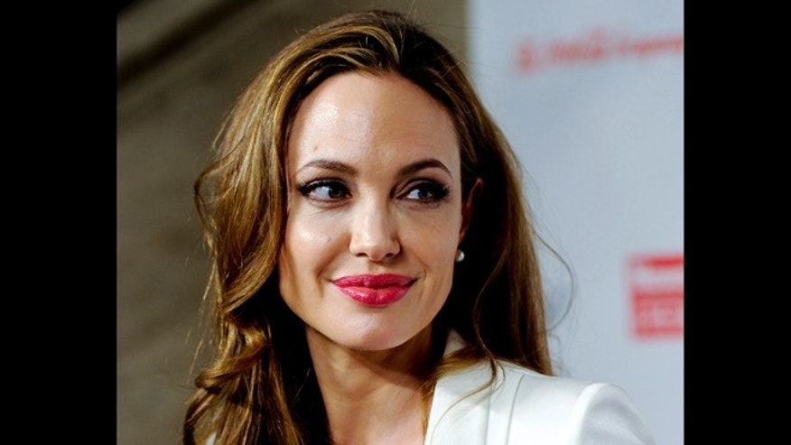 This March 8, 2012 file photo shows actress Angelina Jolie at the Women in the World Summit in New York. Jolie says that she has had a preventive double mastectomy after learning she carried a gene that made it extremely likely she would get breast cancer.