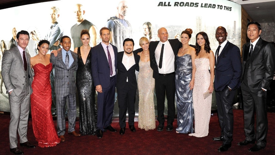 """Actors Luke Evans,  Michelle Rodriquez, Chris Ludacris Bridges, Gal Gadot, Paul Walker, director Justin Lin and actors Elsa Pataky, Vin Diesel, Gina Carano, Jordana Brewster, Tyrese Gibson and Ssung Kang attend the """"Fast & Furious 6"""" World Premiere at The Empire, Leicester Square on May 7, 2013 in London, England.  (Photo by Stuart C. Wilson/Getty Images for Universal Pictures)"""