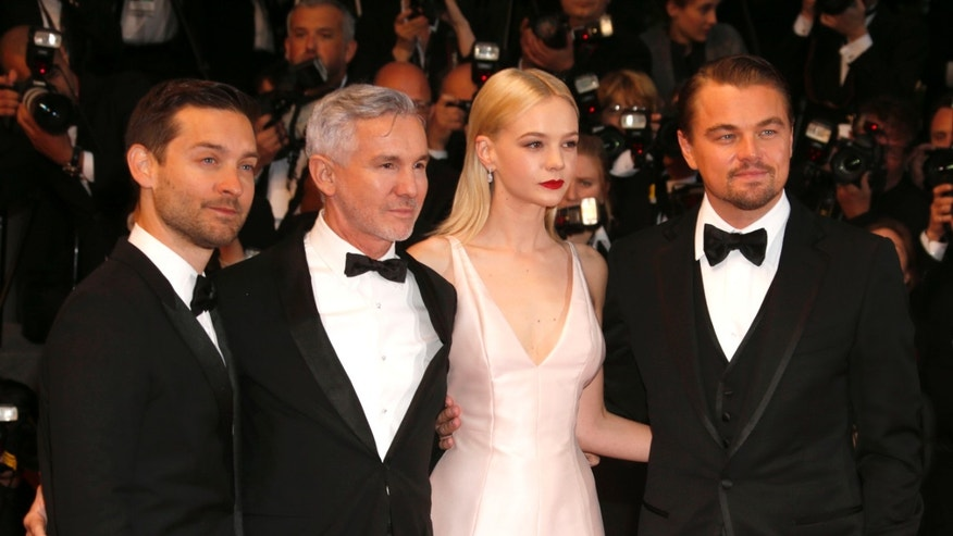 Actor Tobey Maguire, director Baz Luhrmann, actors Carey Mulligan and Leonardo Di Caprio arrive for opening ceremony and the screening of The Great Gatsby at the 66th international film festival, in Cannes, southern France, Wednesday, May 15, 2013. (Photo by Todd Williamson/Invision/AP)