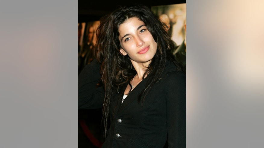 "Actress Tania Raymonde, who appeared on the television series ""Lost"", poses as she arrives at the premiere of the drama film ""Dirty"" in Beverly Hills February 22, 2006."