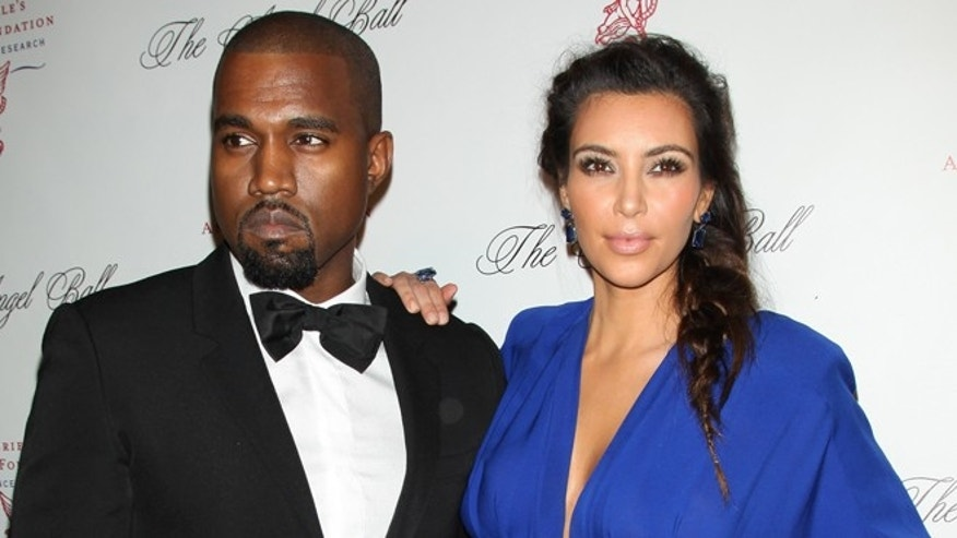 This Oct. 22, 2012 photo released by Starpix shows rapper Kanye West, left, with his girlfriend Kim Kardashian at Gabrielle's Angel Foundation 2012 Angel Ball cancer research benefit at Cipriani Wall Street in New York.