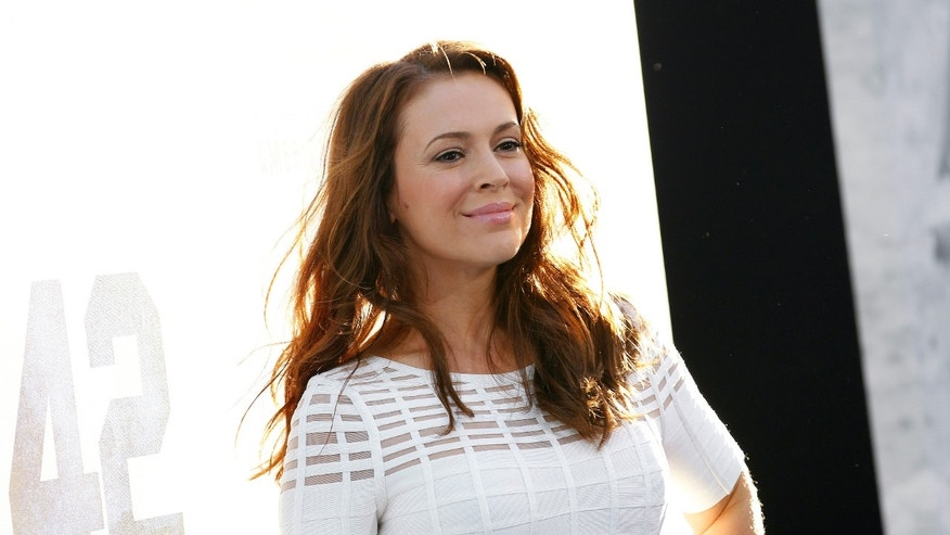 "Actress Alyssa Milano poses at the premiere of ""42"" in Hollywood, California April 9, 2013."