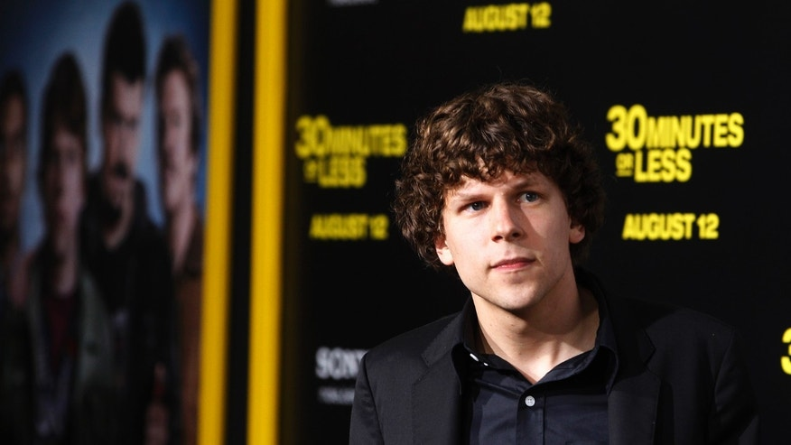 "Actor Jesse Eisenberg poses at the premiere of his new film ""30 Minutes Or Less"" in Hollywood, California, August 8, 2011."