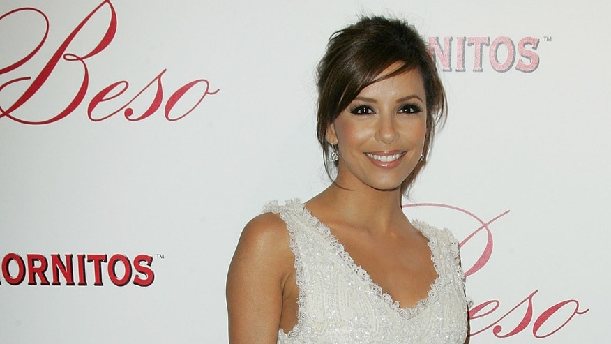 """Actress Eva Longoria arrives at the grand opening for her new restaurant """"Beso"""" on Hollywood Boulevard on March 6, 2008 in Los Angeles, California.  (Photo by Neilson Barnard/Getty Images)"""