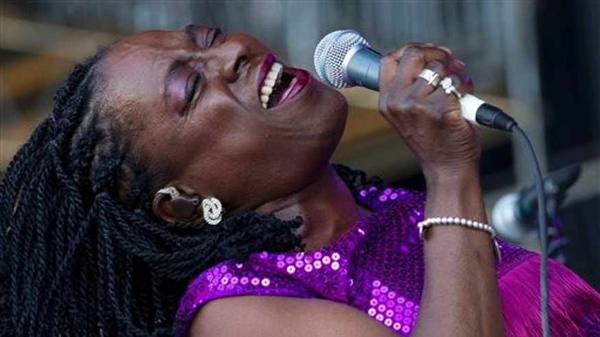This June 8, 2012 file photo shows soul singer Sharon Jones of Sharon Jones and The Dap-Kings performing during the Bonnaroo Music and Arts Festival in Manchester, Tenn.