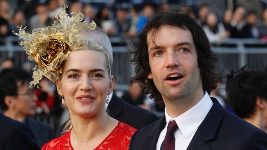 Dec. 9, 2012: In this file photo, British actress Kate Winslet, left, arrives with Ned Rocknroll at the awards presentation of The Longines Hong Kong Cup horse race at the Shatin race track in Hong Kong.