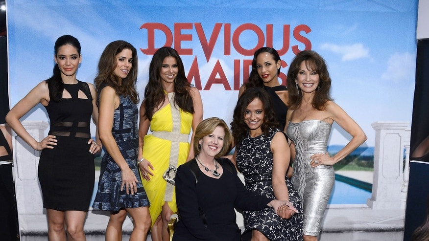 "NEW YORK, NY - MAY 08:  (EDITORS NOTE: This image has been retouched) President and CEO of A+E Networks Abbe Raven poses with the cast of ""Devious Maids"" at the A+E Networks 2013 Upfront  on May 8, 2013 in New York City.  (Photo by Larry Busacca/Getty Images for A+E Networks)"