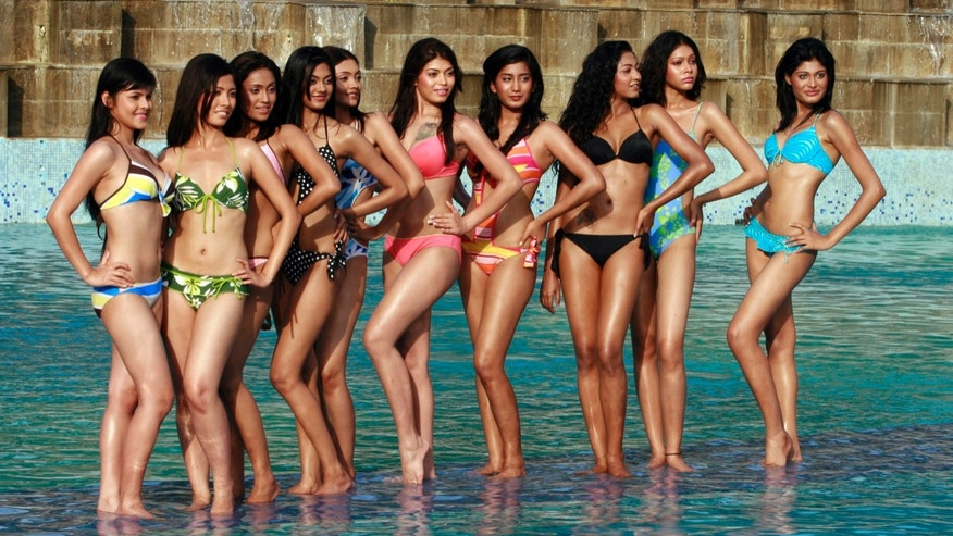 Contestants pose after the swimwear round of beauty contest Sananda Tilottama 2009 in the eastern Indian city of Kolkata June 9, 2008.