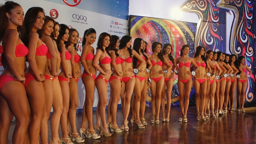 Contestants for Miss World Philippines pose for photographers during a media presentation in Manila June 7, 2012