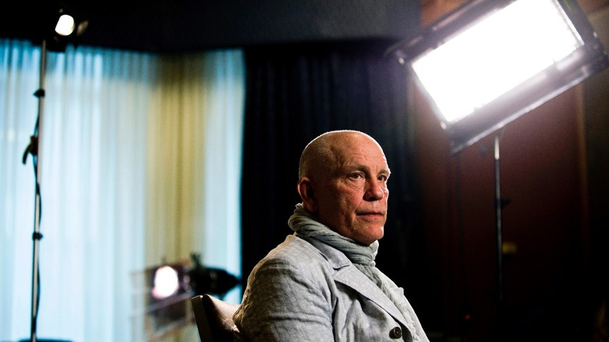 Actor John Malkovich speaks with media at the King Edward Hotel in Toronto to promote his new role as Casanova in The Giacomo Variations, on Thursday, June 6, 2013. The show runs June 7-9. (AP Photo/The Canadian Press, Galit Rodan)