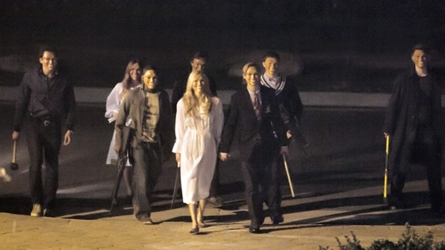 "This film image released by Universal Pictures shows a scene from ""The Purge."""
