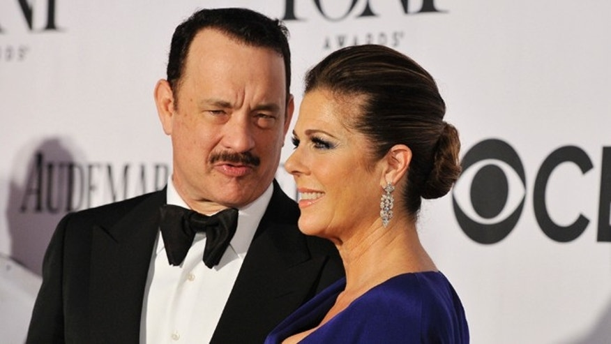 June 9, 2013: Best performance by an actor in a leading role in a play nominee Tom Hanks, left, and actress Rita Wilson arrive on the red carpet at the 67th Annual Tony Awards in New York.