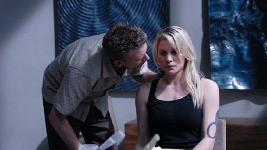 "BATTLESTAR GALACTICA -- ""Occupation/Precipice"" Episode 301/302 -- Pictured: (l-r) Callum Keith Rennie as Leoben, Katee Sackhoff as Kara ""Starbuck"" Thrace -- SCI FI Channel Photo: Carole Segal"
