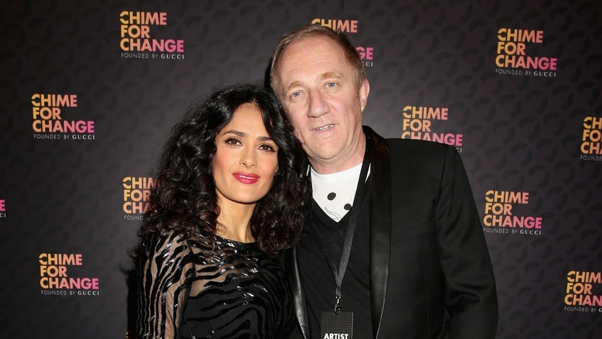 "Salma Hayek Pinault and Francois Henri Pinault arrive at the Royal Box photo wall ahead of the ""Chime For Change: The Sound Of Change Live"" Concert at Twickenham Stadium on June 1, 2013 in London, England."