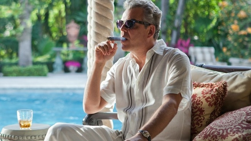 "This publicity image released by Starz, shows Danny Huston in a scene from the second season of the series ""Magic City,"" set in Miami, Fla."