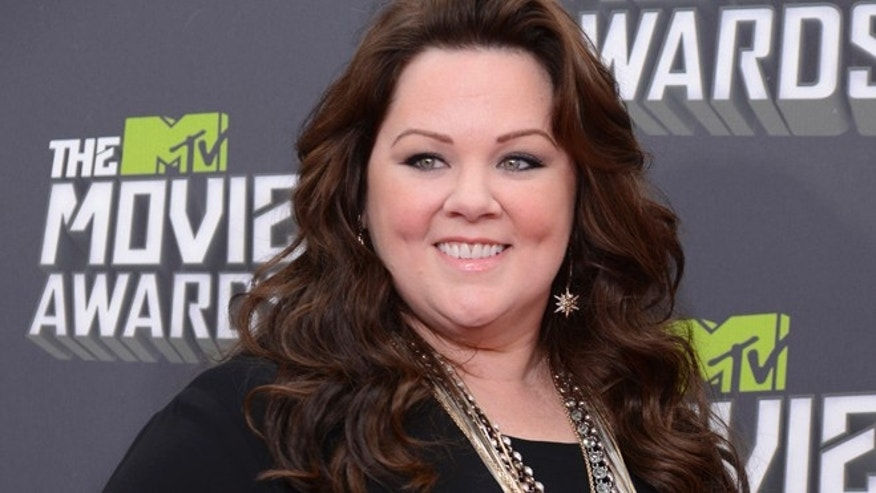 Actress Melissa McCarthy arrives at the 2013 MTV Movie Awards in Culver City, California April 14, 2013.