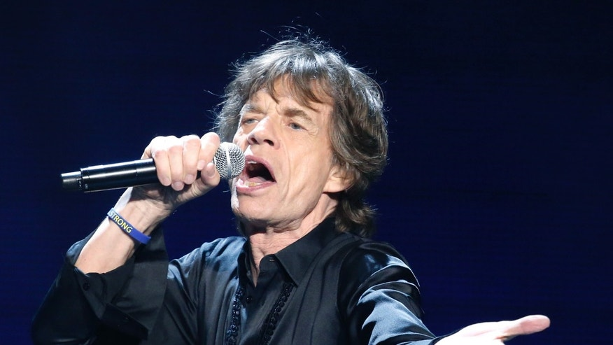 Mick Jagger of the Rolling Stones performs in concert at the TD Garden arena on Wednesday, June 12, 2013 in Boston. (Photo by Bizuayehu Tesfaye/Invision/AP)