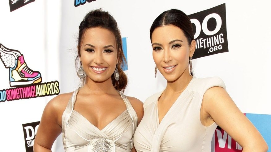 Demi Lovato and best friend Kim Kardashian at the 2011 VH1 Do Something Awards. (Photo by Christopher Polk/Getty Images for VH1)