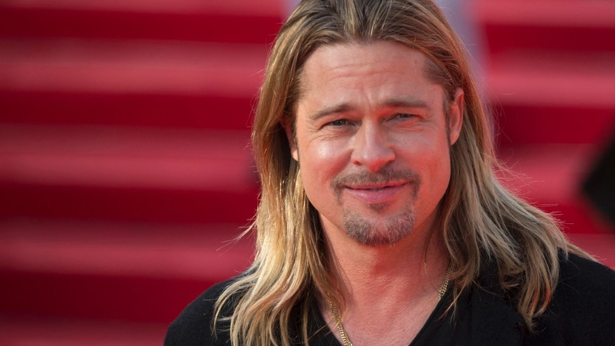 """U.S. actor Brad Pitt poses on the red carpet prior the """"World War Z"""" premiere at the opening ceremony of the 35th Moscow international film festival in Moscow, Russia, Thursday, June 20, 2013. (AP Photo/Alexander Zemlianichenko Jr)"""