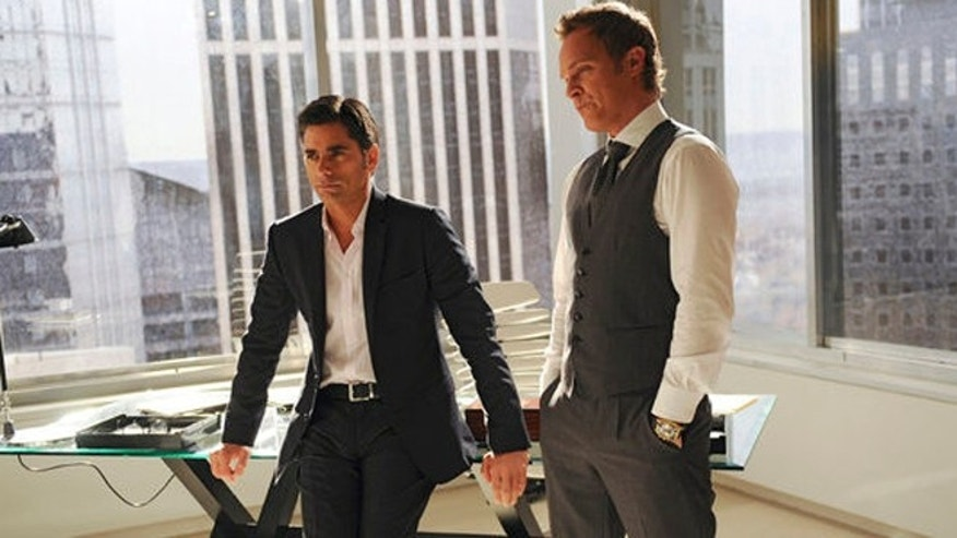 "NECESSARY ROUGHNESS -- ""CH-ch-ch-Changes"" Episode 302 -- Pictured: (l-r) John Stamos as Connor McClane, David Anders as Troy Cutler -- (Photo by: Richard DuCree/USA Network)"