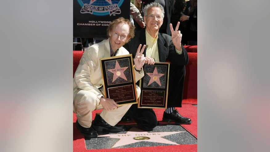 The Doors' guitarist Robby Kreiger, left, and keyboardist Ray Manzarek pose for photographers during the dedication of the 2,329th Star on the Hollywood Walk of Fame in Hollywood February 28, 2007