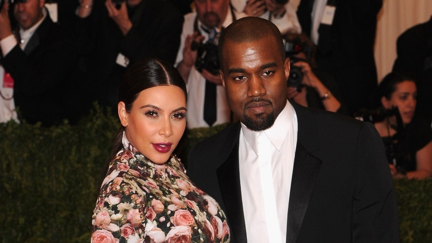 "NEW YORK, NY - MAY 06:  Kim Kardashian and  Kanye West attend the Costume Institute Gala for the ""PUNK: Chaos to Couture"" exhibition at the Metropolitan Museum of Art on May 6, 2013 in New York City.  (Photo by Jamie McCarthy/Getty Images for The Huffington Post) *** Local Caption *** Kim Kardashian; Kanye West"