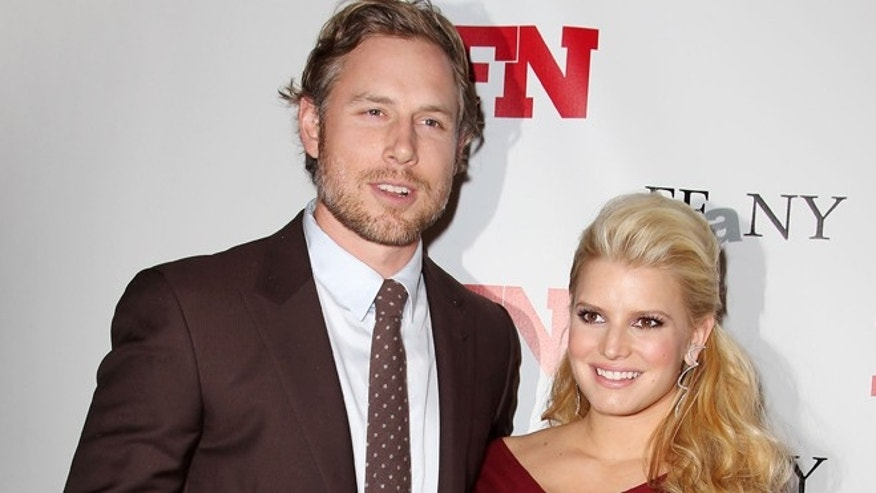 Nov. 29, 2011: In this file photo, singer Jessica Simpson, right, poses with Eric Johnson at the 25th Annual Footwear News Achievement Awards at The Museum of Modern Art in New York.