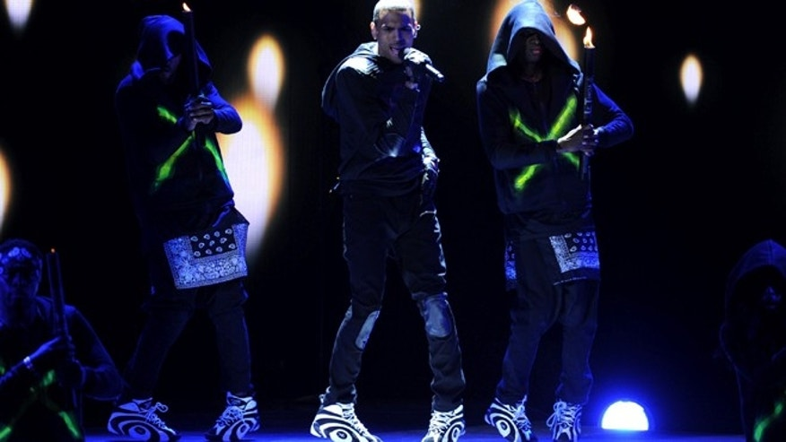 June 30, 2013: Chris Brown performs onstage at the BET Awards at the Nokia Theatre in Los Angeles.