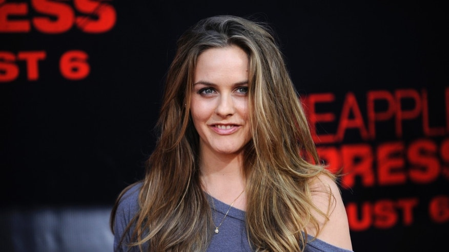 "Actress Alicia Silverstone attends the premiere of the film ""Pineapple Express"" in Los Angeles July 31, 2008."