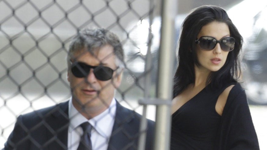 Alec Baldwin and wife Hilaria Thomas at James Gandolfini's funeral on June 27, 2013.