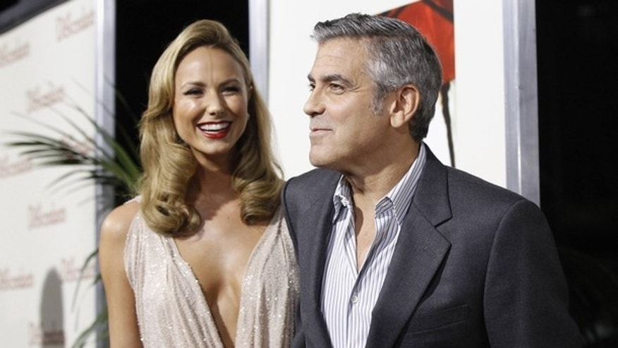 "Cast member George Clooney and actress Stacy Keibler arrive at the premiere of ""The Descendants"" at the Samuel Goldwyn Theater in Beverly Hills, California November 15, 2011. The movie opens in the U.S. on Wednesday.  REUTERS/Mario Anzuoni (UNITED STATES - Tags: ENTERTAINMENT)"