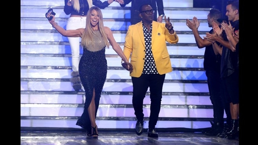 "May 16, 2013: Judges Mariah Carey, left, and Randy Jackson walk on stage at the ""American Idol"" finale at the Nokia Theatre at L.A. Live in Los Angeles."