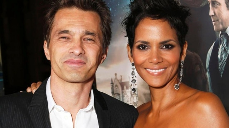 "Actors Olivier Martinez, left, and Halle Berry at the Los Angeles premiere of Berry's film, ""Cloud Atlas,"" in the Hollywood section of Los Angeles."
