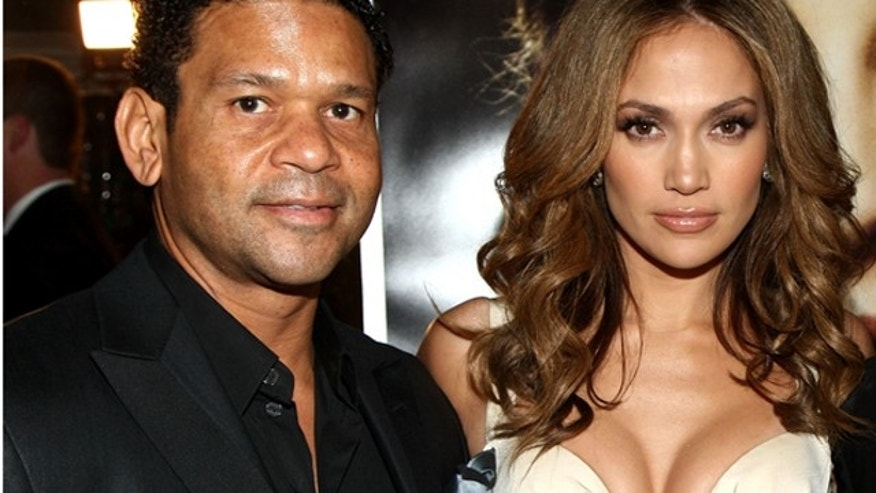 """WESTWOOD, CA - DECEMBER 08:  Celebrity agent Benny Medina, actress/singer Jennifer Lopez and CEO of Paramount Pictures Brad Grey arrive at the premiere of Paramount's """"The Curious Case Of Benjamin Button"""" held at Mann's Village Theatre on Decemeber 8, 2008 in Westwood, California.  (Photo by Alberto E. Rodriguez/Getty Images)"""