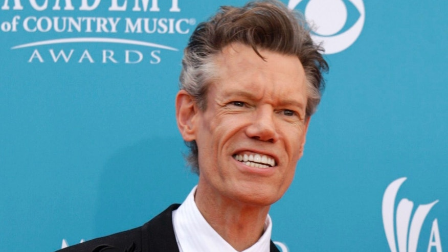 Singer Randy Travis arrives at the 45th annual Academy of Country Music Awards in Las Vegas.